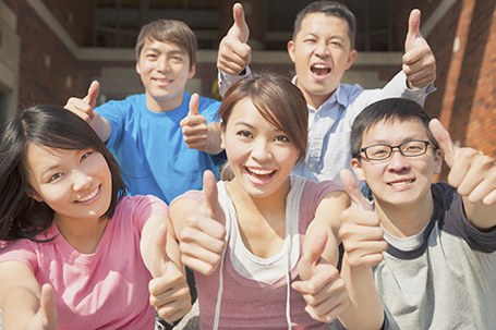 Group of happy students with thumbs up